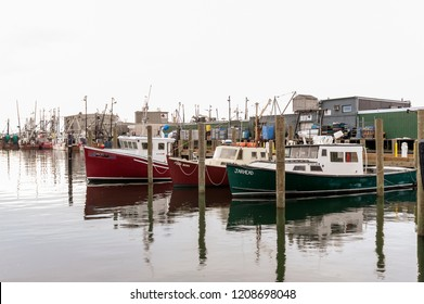 New Bedford, Massachusetts, USA - October 13, 2018: Commercial fishing boats Sea Horse, Seas the Deal and Jarhead docked at Coalpocket Pier on New Bedford waterfront