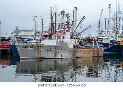 New Bedford, Massachusetts, USA - October 13, 2018: Commercial fishing vessel Lady Dee, hailing port Yarmouth, MA, docked with other boats at Steamship Pier