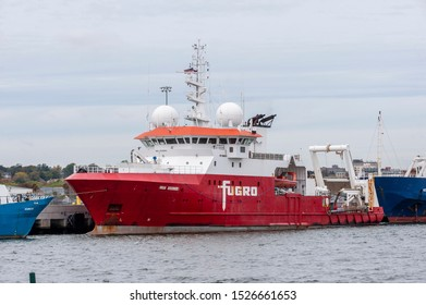 New Bedford, Massachusetts, USA – October 8, 2019: Geotechnical survey vessel Fugro Discovery  docked at Marine Commerce Terminal under cloudy skies