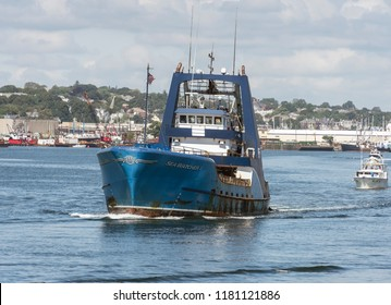 New Bedford, Massachusetts, USA - September 15, 2018: Commercial fishing vessel Sea Watcher 1 amid string of boats leaving New Bedford