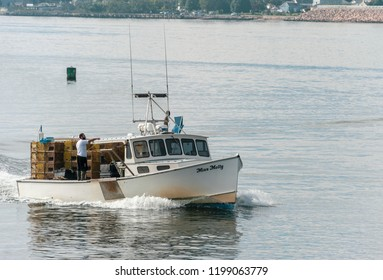 New Bedford, Massachusetts, USA - September 15, 2018: Lobster boat Miss Molly approaching New Bedford with stacks of lobster pots