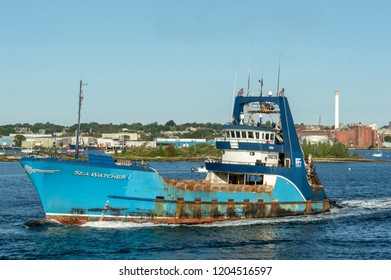 New Bedford, Massachusetts, USA - September 30, 2018: Commercial fishing vessel Sea Watcher I crossing Acushnet River with Palmer Island in background