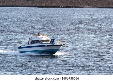 New Bedford, Massachusetts, USA - September 2, 2018: Cabin cruiser approaching New Bedford in early evening