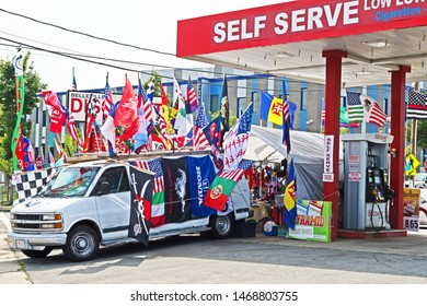 New Bedford, Massachusetts/USA - August 2 2019: a souvenir stand is set up next to a self service gas station in proximity to the Feast of the Blessed Sacrament in New Bedford.