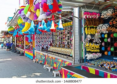 New Bedford, Massachusetts/USA - August 2 2019: a row of brightly colored side shows featuring various games await visitors to the  Feast of the Blessed Sacrament in New Bedford.