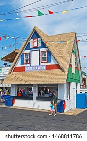 New Bedford, Massachusetts/USA - August 2 2019: a stall in the form of a traditional house offers Madeira Wine to visitors to the Feast of the Blessed Sacrament in New Bedford.