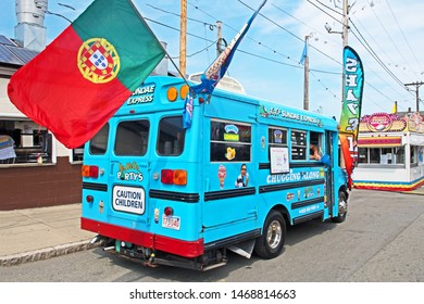 New Bedford, Massachusetts/USA - August 2 2019: a blue ice cream van flying the Portuguese flag awaits visitors to the Feast of the Blessed Sacrament in New Bedford.