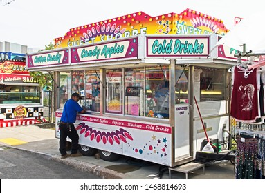 New Bedford, Massachusetts/USA - August 2 2019: a brightly colored candy and drinks stall awaits visitors to the Feast of the Blessed Sacrament in New Bedford.