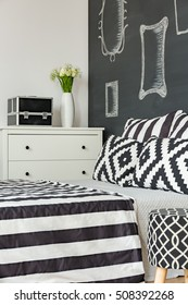 New bedroom with black wall and pattern bedding