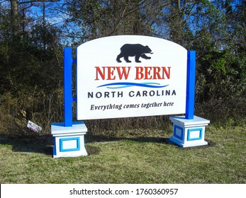 """New Bern, NC / USA - 12/31/2014 - Welcome sign of the city of New Bern, NC, USA near Highway 17 /70. """"Everything comes together here"""" refers to two rivers floating together in this city."""