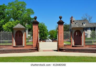 New Bern, North Carolina - April 24, 2016:  Brick and wrought iron entry gate flanked by two circular sentry booths at 1770 Tryon Palace *