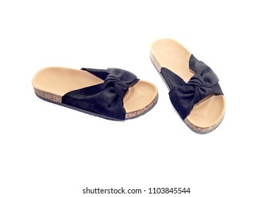 New, black, female sandals close-up on a white background