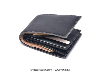 New Black leather wallet with banknotes and credit card isolated on white background.