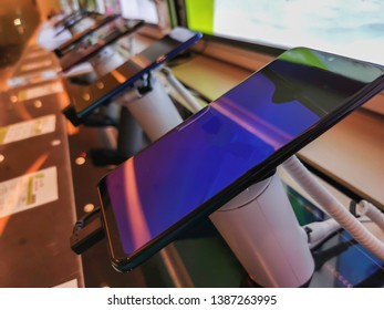 New black mobile smartphones exposed in electronic store, with touchscreen, digital gadget for internet and telecommunication.