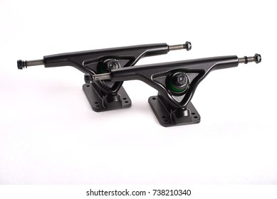 New Black Skateboard Parts on a White Background, truck. Skateboard truck sits on a White background.