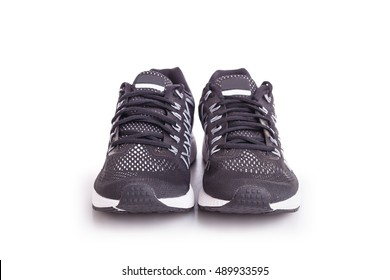 New black sneakers shoe. Taken at studio and isolated on white background