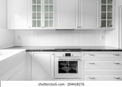 New black and white kitchen with retro details, frontal view