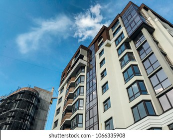 New block of modern apartments with balconies and blue sky in the background, Ukraine