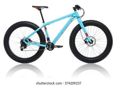 New blue bicycle with thick tires for snow ride isolated on a white background