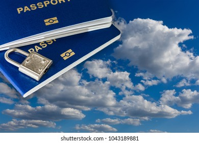 New blue biometric passport with identification chip on against blue sky