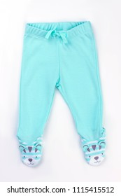 New blue footed pants for baby with feet. Fashion clothing for infants on white isolated background, top view.