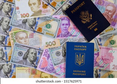 New blue Ukrainian electronic passport of dual citizens and American passpor let Ukrainian hryvna, American banknotes dollar bill