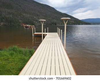 A new boat dock at Grand Lake in Colorado.  The Rocky Mountains are rising up beside the lake.