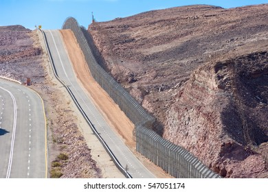 The new border fence between Israel (Negev Desert) and Egypt (Sinai Desert) with the patrol road protecting the border