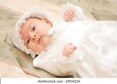 New born baby girl dressed for christening.