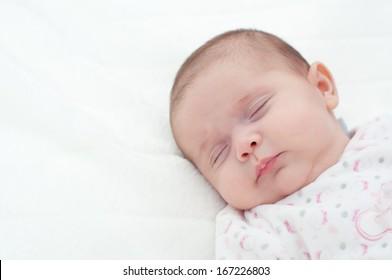 new born baby girl sleeping. Portrait