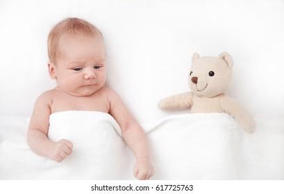 New born Baby girl sleeping with her teddy bear