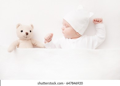 New born Baby girl sleeping with her teddy bear