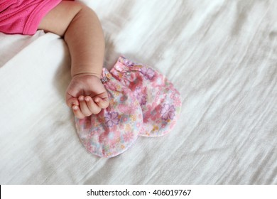 New Born Baby Hand with Pink Color Gloves, White Blanket