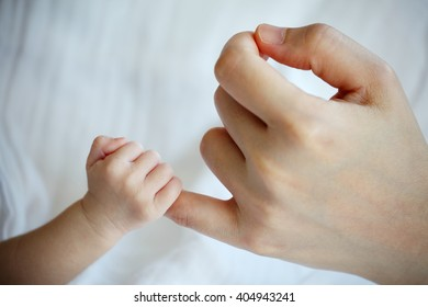 New Born Baby's Hand Gripping Mother's Little Finger