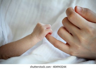 New Born Baby's Hand Gripping Mother Little Finger