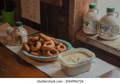 New Boston, N.H./USA - March 25, 2018. Samples of apple cider doughnuts and maple cream for visitors to a sugar shack on New Hampshire Maple Weekend. Producers make syrup in March when the sap runs.