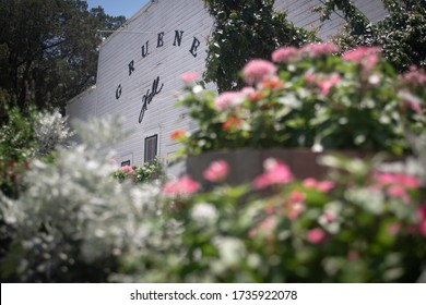 New Braunfels, Texas - May 19 2020: Gruene Hall with flowers in the foreground