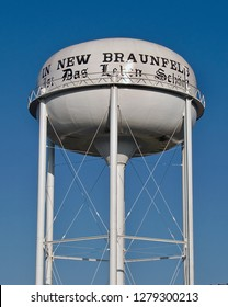 New Braunfels, Texas / USA -  March 18 2008: Multi-Column Elevated Water Tower painted with the city motto in German.