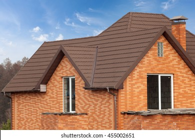 New brick house with modular chimney, Stone Coated Metal Roof Tile, plastic windows and rain gutter