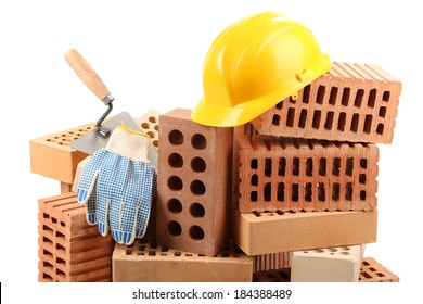 New bricks and building tools, isolated on white