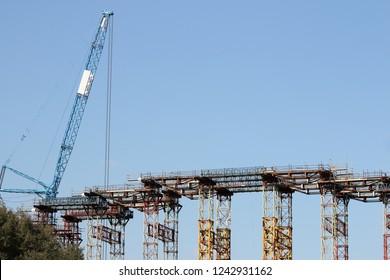 new bridge and crane heavy machinery construction site