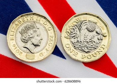 New British pound coin showing heads and tails on a Union Jack flag background. Close up detail of the bimetallic coin introduced in March 2017.
