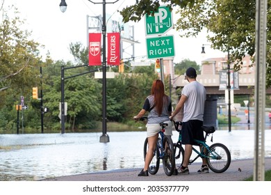 New Brunswick, New Jersey - September 2, 2021: Local residents view flooded downtown streets in the aftermath of Tropical Storm Ida.