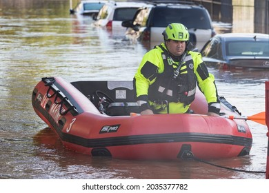 New Brunswick, New Jersey - September 2, 2021: Inflatable raft brings rescue worker through the flooded downtown streets in the aftermath of Tropical Storm Ida.