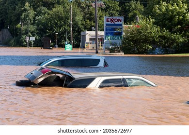 New Brunswick, New Jersey - September 2, 2021: Cars submerged underwater and flooded gas station in the aftermath of Tropical Storm Ida.