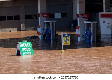 New Brunswick, New Jersey - September 2, 2021: Gas pumps at gas station submerged under flood water in the aftermath of Tropical Storm Ida.