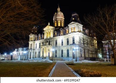 The New Brunswick Legislative Assembly building at night.