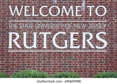 NEW BRUNSWICK, NJ - JULY 15: A sign at an entrance to Rutgers University in New Brunswick, New Jersey on July 15, 2017. Rutgers, The State University of New Jersey, is a public research university.
