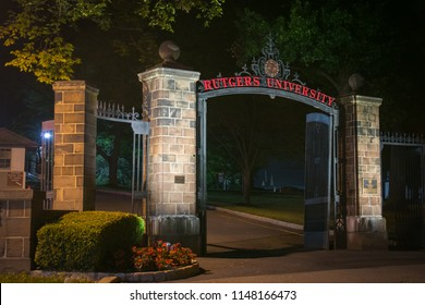 New Brunswick, NJ - July 30, 2018: Night time view of gates to Rutgers University (Old Queens Campus).