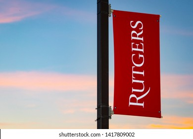 New Brunswick, NJ - June 6, 2019: Rutgers University logo on banner against colorful skies